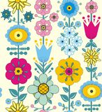 Purple, pink, blue and yellow flowers and leaves. A seamless pattern of purple, pink, blue and yellow flowers and leaves on a white background Royalty Free Stock Photography