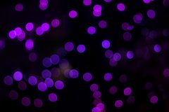 Purple bokeh abstract background. Purple lights defocused bokeh abstract texture. Purple and pink bokeh abstract background. Purple lights defocused bokeh royalty free stock images