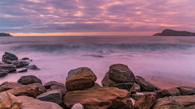 Purple and Pink Break of Dawn Seascape. Looking out towards Lion Island from Pearl Beach, Central Coast, NSW, Australia Royalty Free Stock Image
