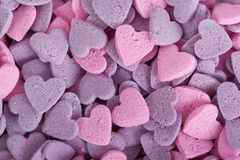 Purple and pink candy hearts Stock Images