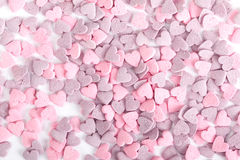 Purple and pink candy hearts Stock Photography