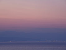 Purple and Pink Color Gradation of Sunset Sky over the Mountain range and Adriatic Sea Royalty Free Stock Photo