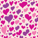 Purple, pink hearts on a beige background Stock Photography