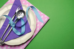 Purple & pink hearts dinner table place setting - with copy space. Stock Photo