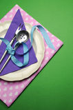Purple & pink hearts dinner table place setting -  vertical with copy space. Stock Image