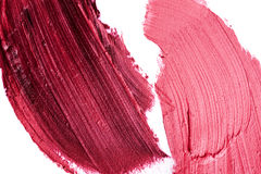 Purple and pink Lipstick Smudges. On white Surface Stock Images