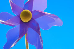 Purple Pinwheel Closeup. With a blue background Royalty Free Stock Photography