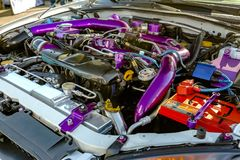 Purple pipes under the hood of modern car Stock Photography