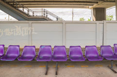 Purple plastic benches in railway station Royalty Free Stock Image