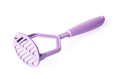 Purple plastic potato masher isolated on white Royalty Free Stock Photography