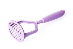 Purple plastic potato masher isolated on white Royalty Free Stock Photography