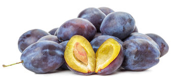 Purple plums isolated on the white background Royalty Free Stock Images