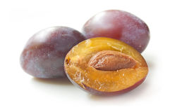 Purple plums on white background Stock Photo