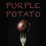 Purple potato on a black background Stock Photography