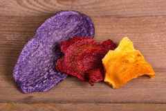 Purple potato, parsnip and beet chips Stock Images