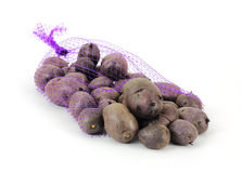 Purple Potatoes and Bag Stock Photography
