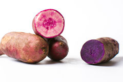 Purple potatoes isolated on white background, Royalty Free Stock Images
