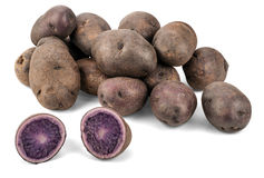 Purple Potatoes. The Purple potato (botanical name Solanum andigenum), also known as Blue Potatoes or Vitelotte, is native to the Lake Titicaca within the high Stock Image