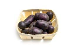 Purple potatoes on white Royalty Free Stock Photo