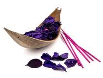 Purple potpourri and pink incenses Stock Photos