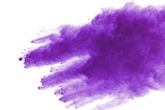 Purple powder explosion on white background. Colored cloud. Colorful dust explode. Paint Holi stock photo