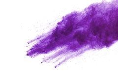 Purple powder explosion on white background. Colored cloud. Colorful dust explode. Paint Holi stock image