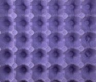 Purple protective tray for raw chicken eggs with cells, full frame. Close up royalty free stock photos
