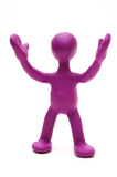 Purple puppet of plasticine signing by hands Stock Images