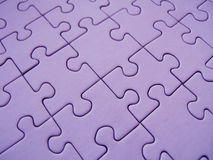 Purple puzzle Royalty Free Stock Photos