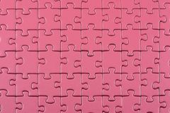 Purple puzzle background. Surface of linked puzzle pieces Stock Photos
