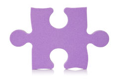 Purple puzzle piece. Over a white background Royalty Free Stock Image