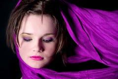 Purple rain. Face of women wearing a purple scarf Royalty Free Stock Photo