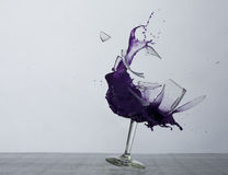 Purple Rain. Breaking a glass with a green liquid inside Royalty Free Stock Images
