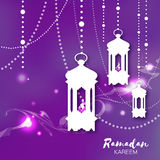 Purple Ramadan Kareem celebration greeting card. Hanging arabic lamps Stock Image