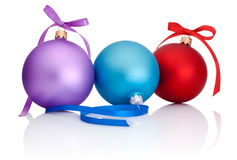 Purple, red and blue Christmas Ball with ribbon bow. On white background Royalty Free Stock Photos