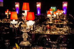 Decor for a large party or gala dinner. Purple and red decor with candles and lamps for corporate event or gala dinner Royalty Free Stock Photos