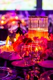 Decor for a large party or gala dinner. Purple and red decor with candles and lamps for corporate event or gala dinner Stock Photography