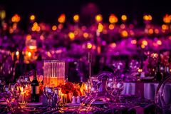 Decor for a large party or gala dinner. Purple and red decor with candles and lamps for corporate event or gala dinner Royalty Free Stock Images