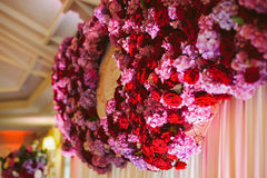 Purple & red flowers wedding reception garland Stock Image