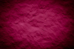 Purple red grunge texture. Purple red grunge wall background texture with dark spots Stock Photography