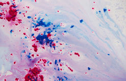 Purple and red paint in water royalty free stock image