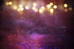 Purple, red, pink, gold and black glitter lights background. defocused. stock photos