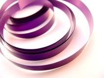 Purple ribbon Stock Images