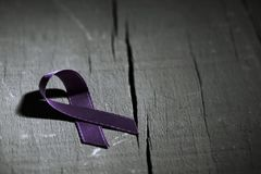 Purple ribbon against the violence against women Stock Image