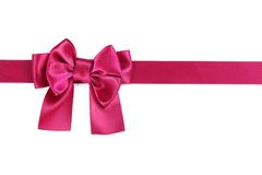 Purple ribbon with bow Stock Images