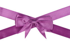 Purple ribbon with bow Stock Photography