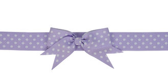 Purple ribbon with bow. Isolated on white background Royalty Free Stock Photography