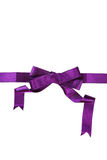 Purple ribbon with bow on a white background Royalty Free Stock Image