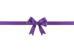 Purple ribbon with a bow. On white background Royalty Free Stock Image