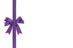 Purple ribbon with a bow Stock Photos